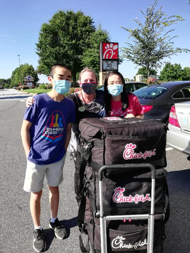 Arthur and Ingrid Gao of Johns Creek, GA feed local healthcare workers Chick-fil-A Chicken Sandwiches