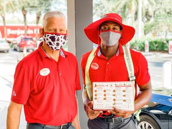Marcus and David, now coworkers at the Boynton Beach, Fl. Chick-fil-A