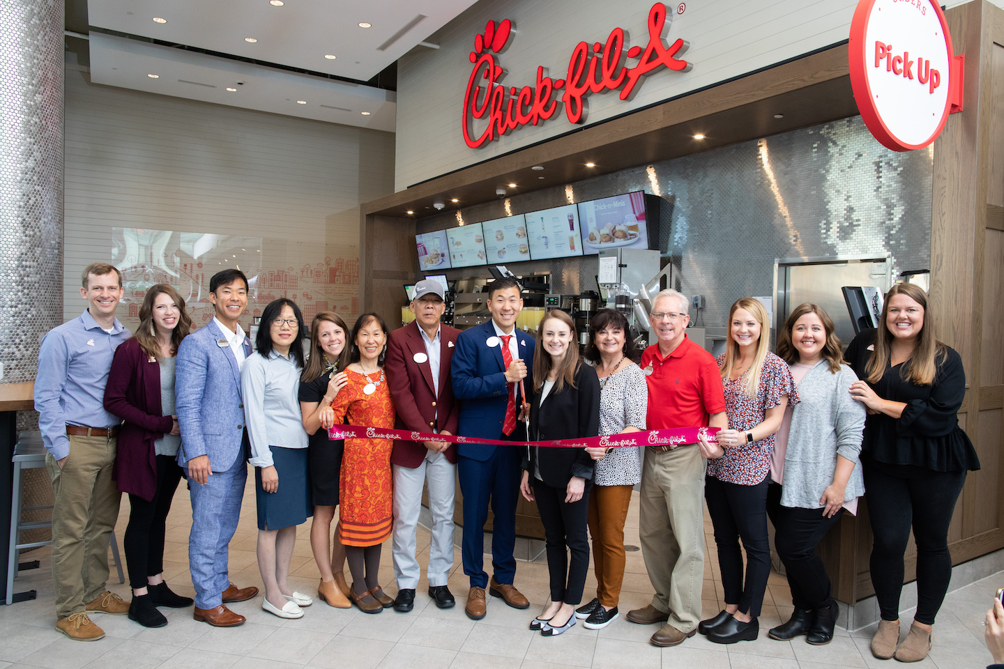 Chick-fil-A Toronto Team standing in front of the restaurant at the Grand Opening last year