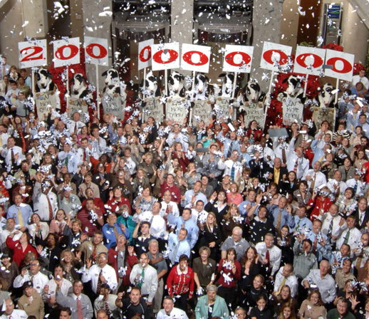 A large group of Chic-fil-A operators and stafff celebrating 2 billion in sales