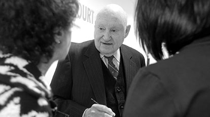 Truett Cathy speaking with customers