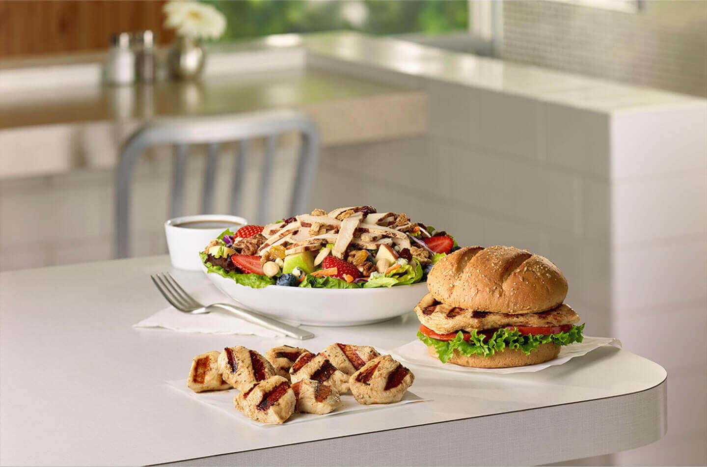 Grilled chicken sandwich, grilled chicken nuggets, and a grilled chicken salad