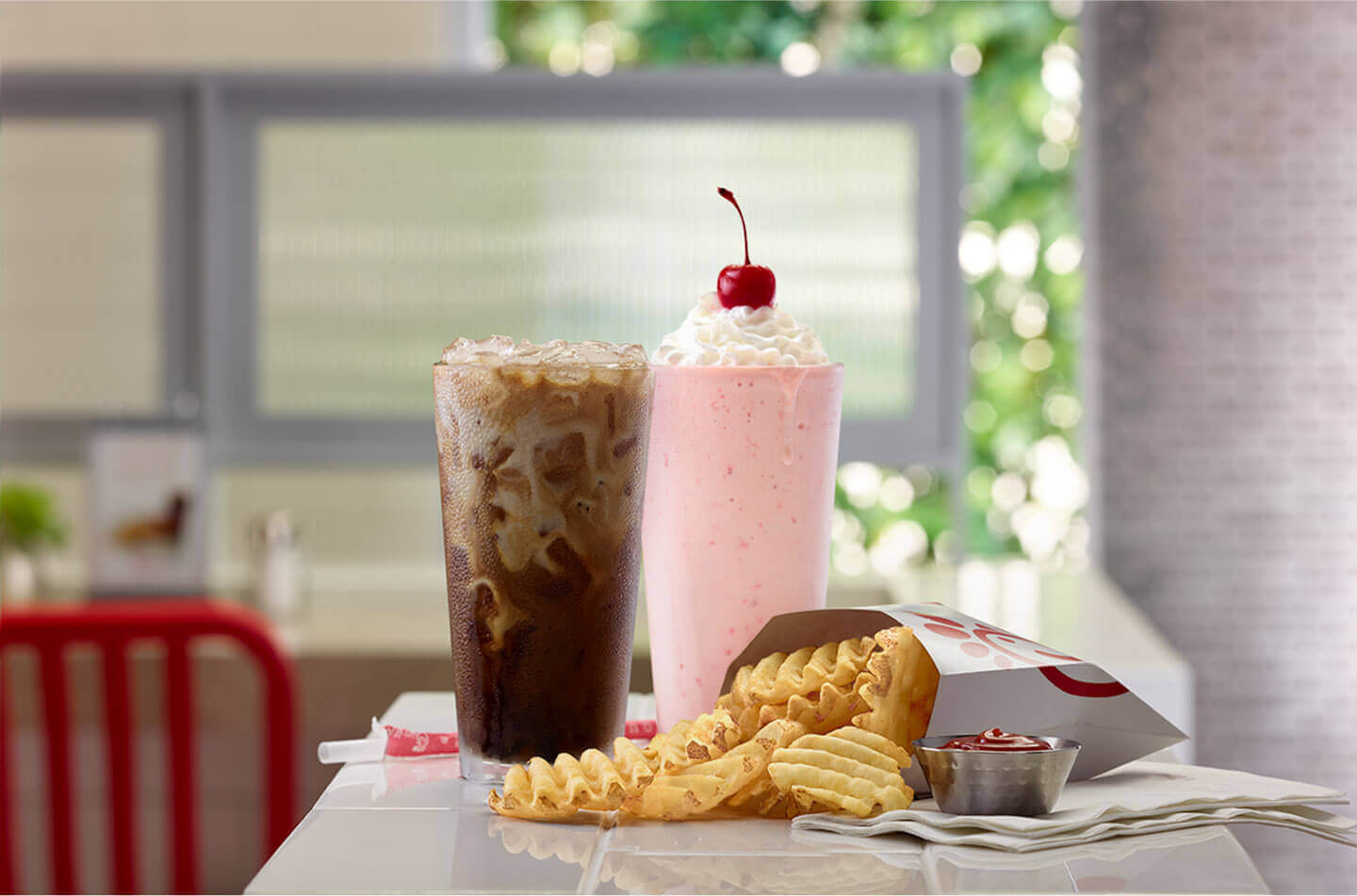 Strawberry milkshake, soda, and french fries