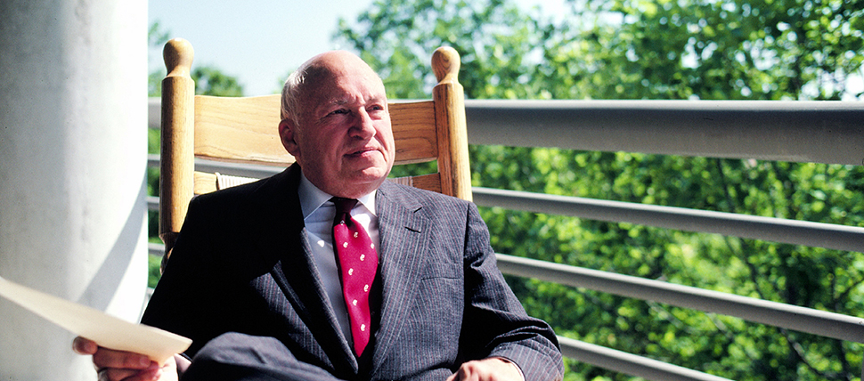 Truett Cathy sitting in a rocking chair