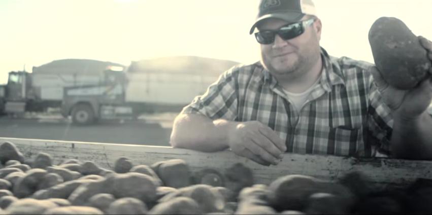 Potato farmer with potatoes