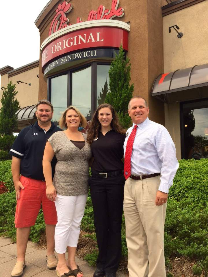 Wilson family photo in front of the same restaurant they worked at 25 years ago