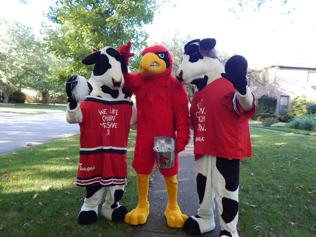 Cow mascot with Cardinals mascot
