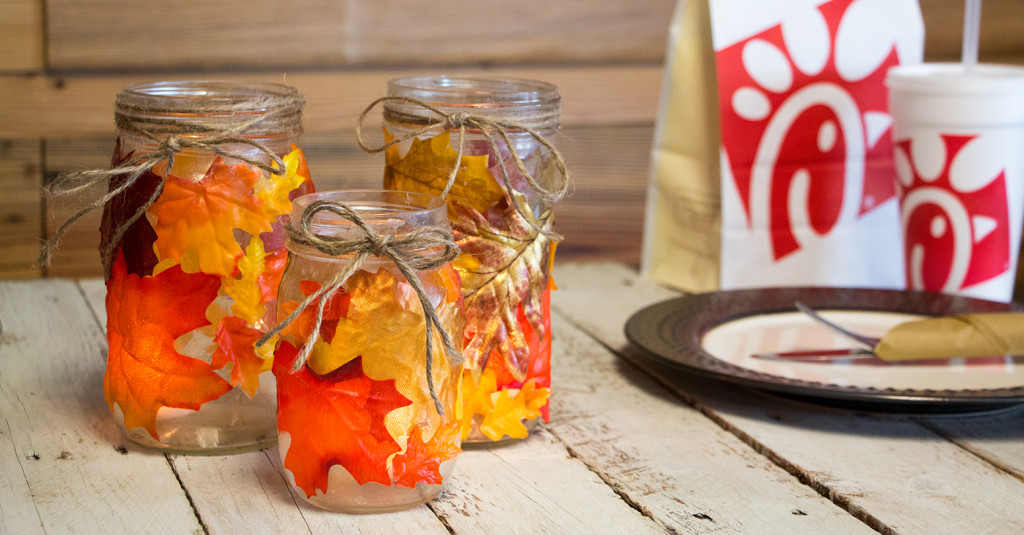 A display of leaf decorated mason jars