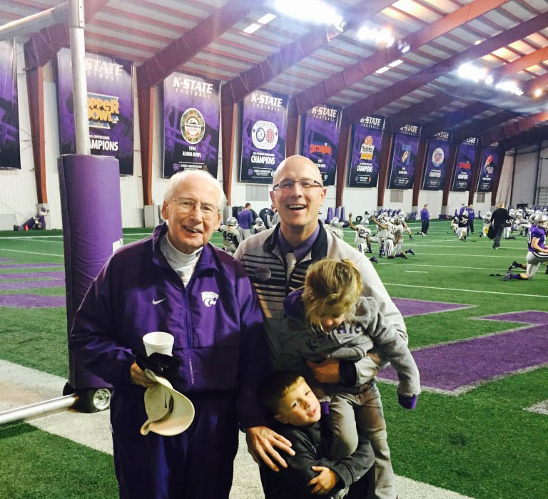 Coach Bill Snyder alongside David Hamel and Hamel's children