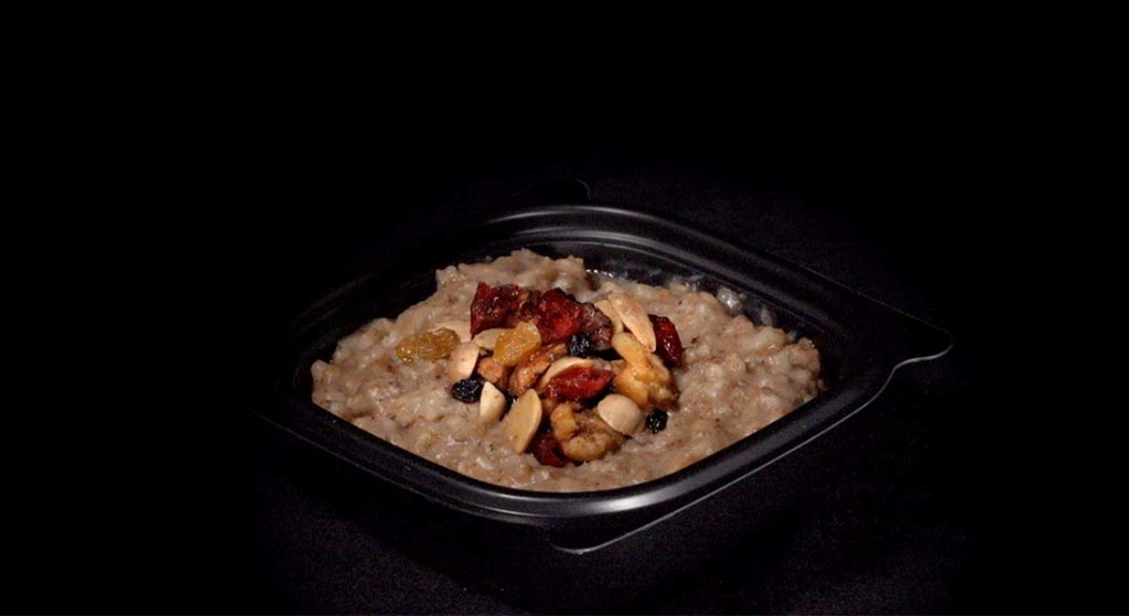 Bowl of oatmeal with dried fruit and nuts
