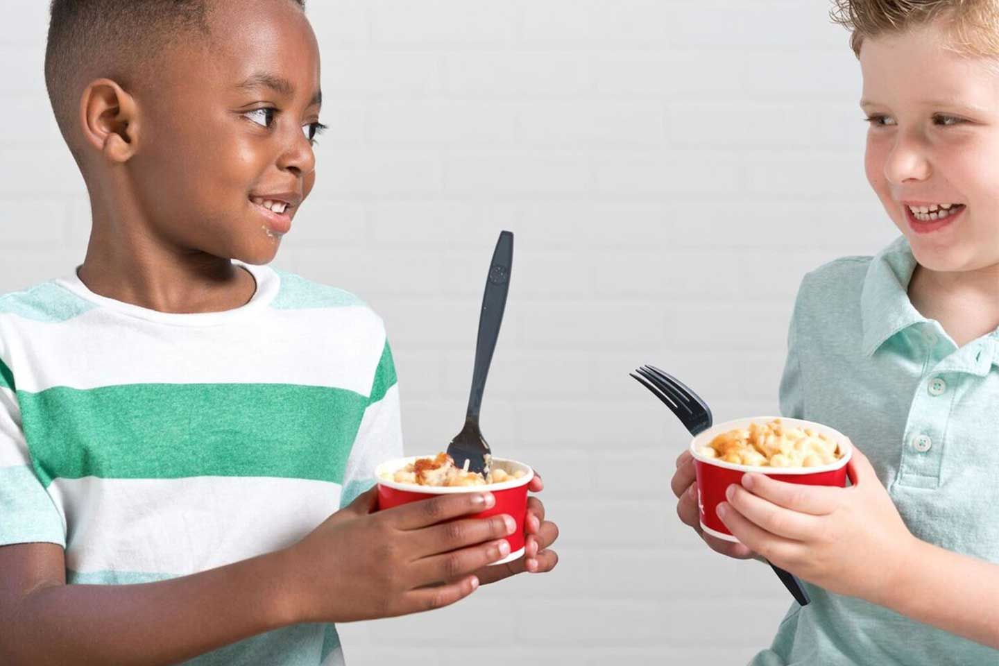 boys eating from chick-fil-a sustainable bowls