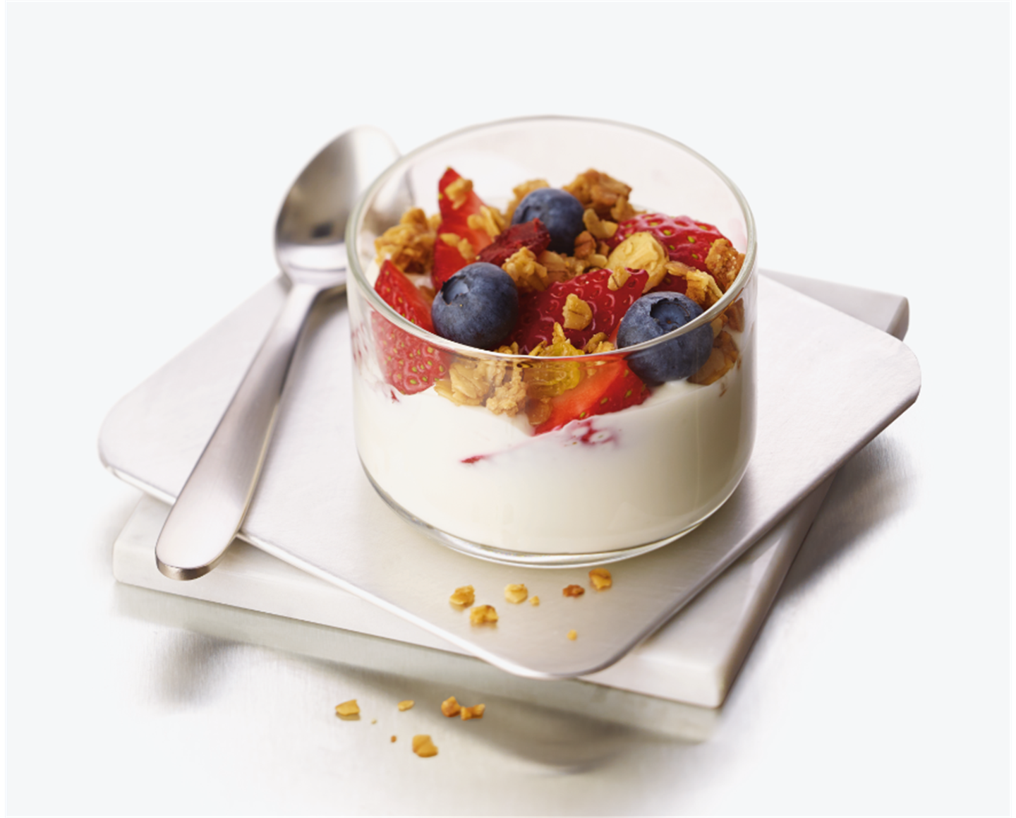 Greek yogurt parfait with fresh strawberries and blueberries topped with  Chick-fil-A Harvest Nut Granola